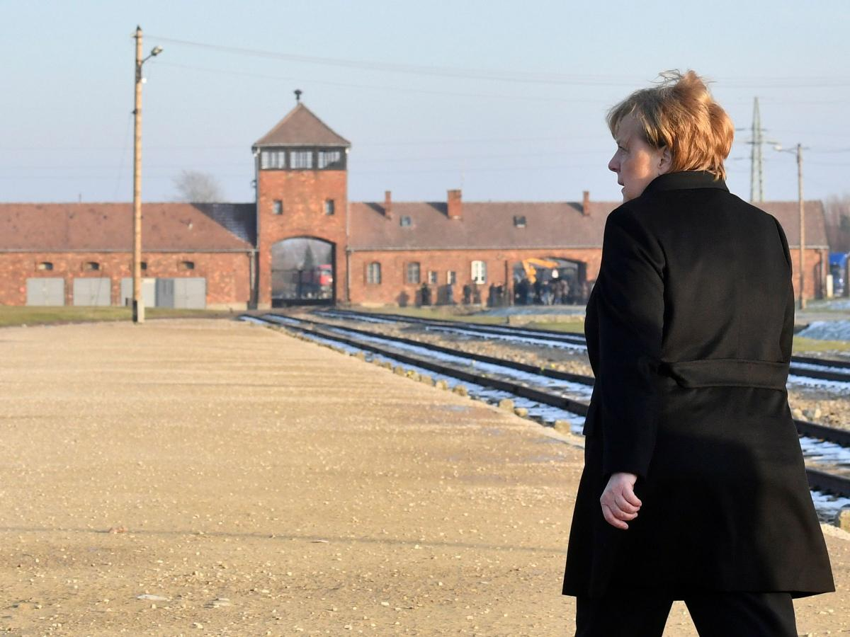 German Chancellor Angela Merkel walks toward the main railway entrance to Birkenau, the largest of the camps that made up the Auschwitz complex in Poland. It was the German chancellor's first visit to the former Nazi death camp, an enduring symbol of the