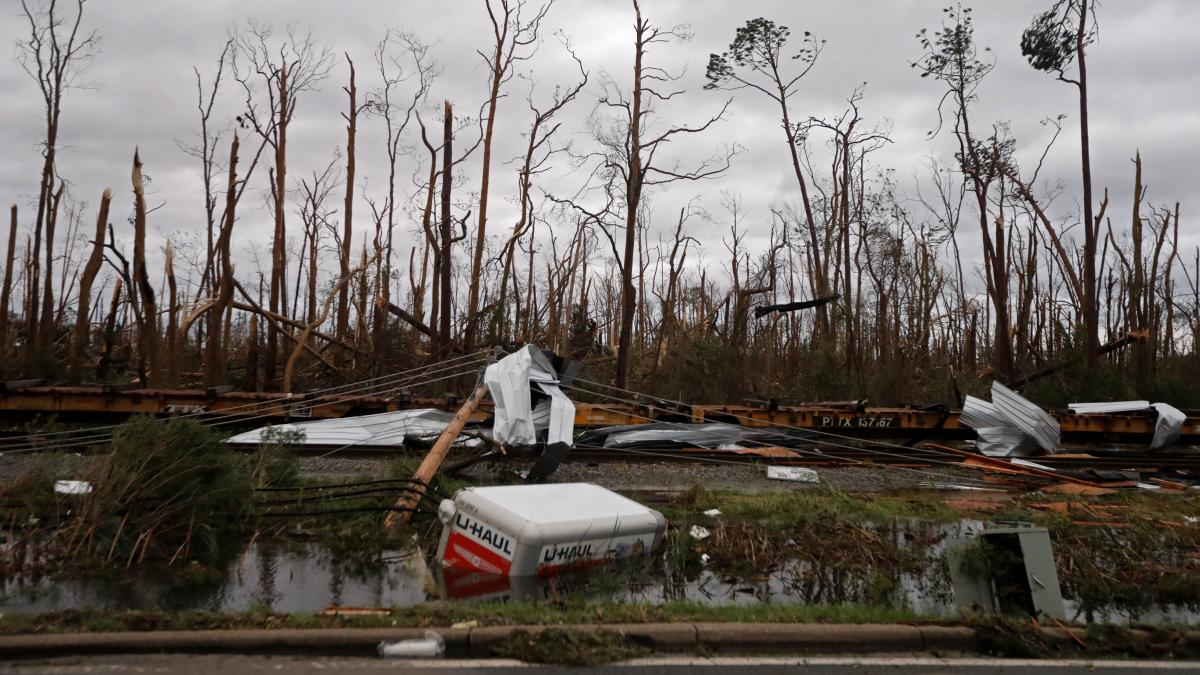 Downed power lines, shredded trees, derailed train cars and a sunken trailer are seen Wednesday in the aftermath of Hurricane Michael in Panama City, Fla.