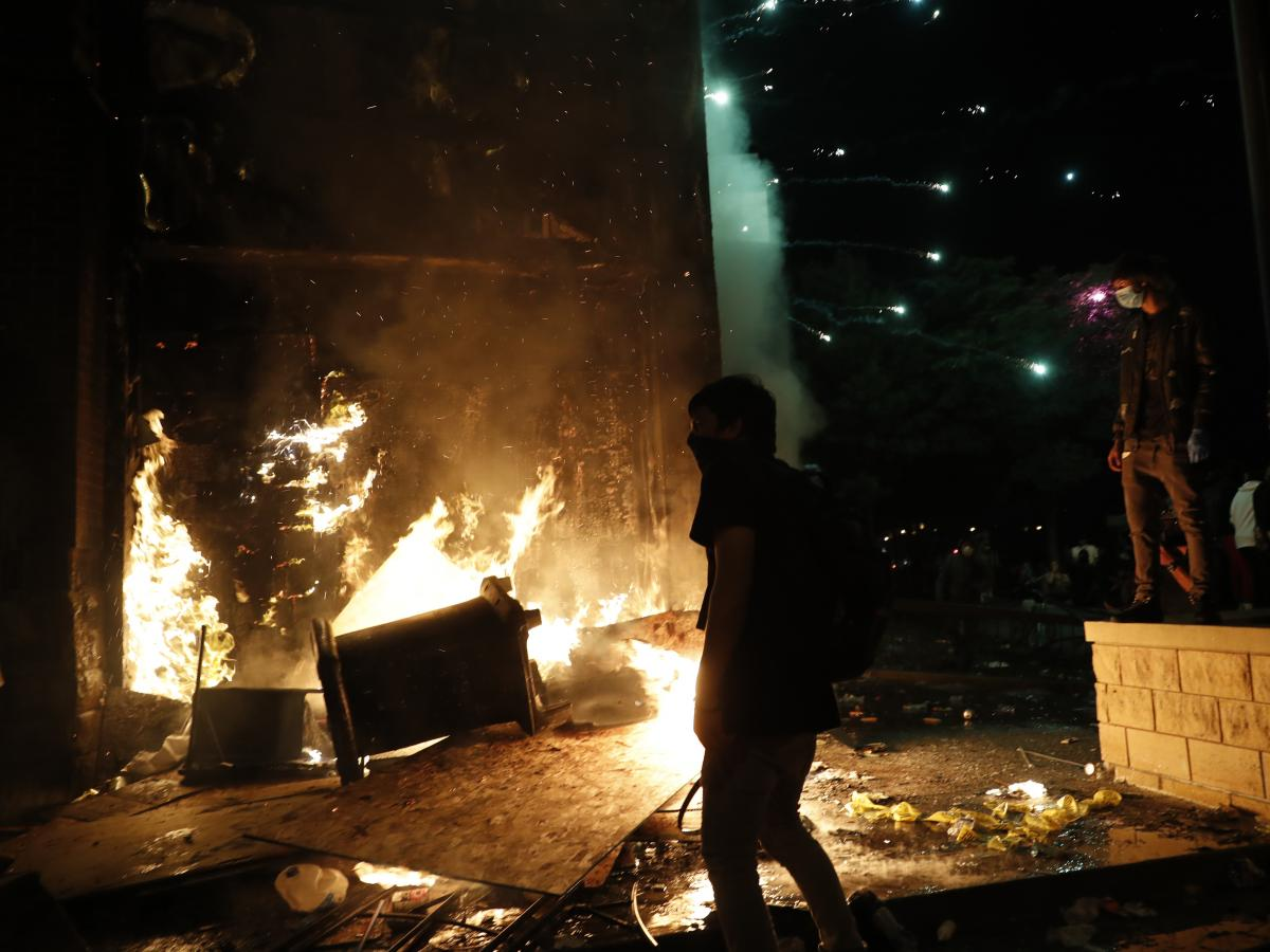 Protesters set fires at the 3rd Precinct of the Minneapolis Police Department, Thursday, May 28, 2020, in Minneapolis. Protests over the death of George Floyd, the black man who died in police custody, continued in Minneapolis for a third straight night.