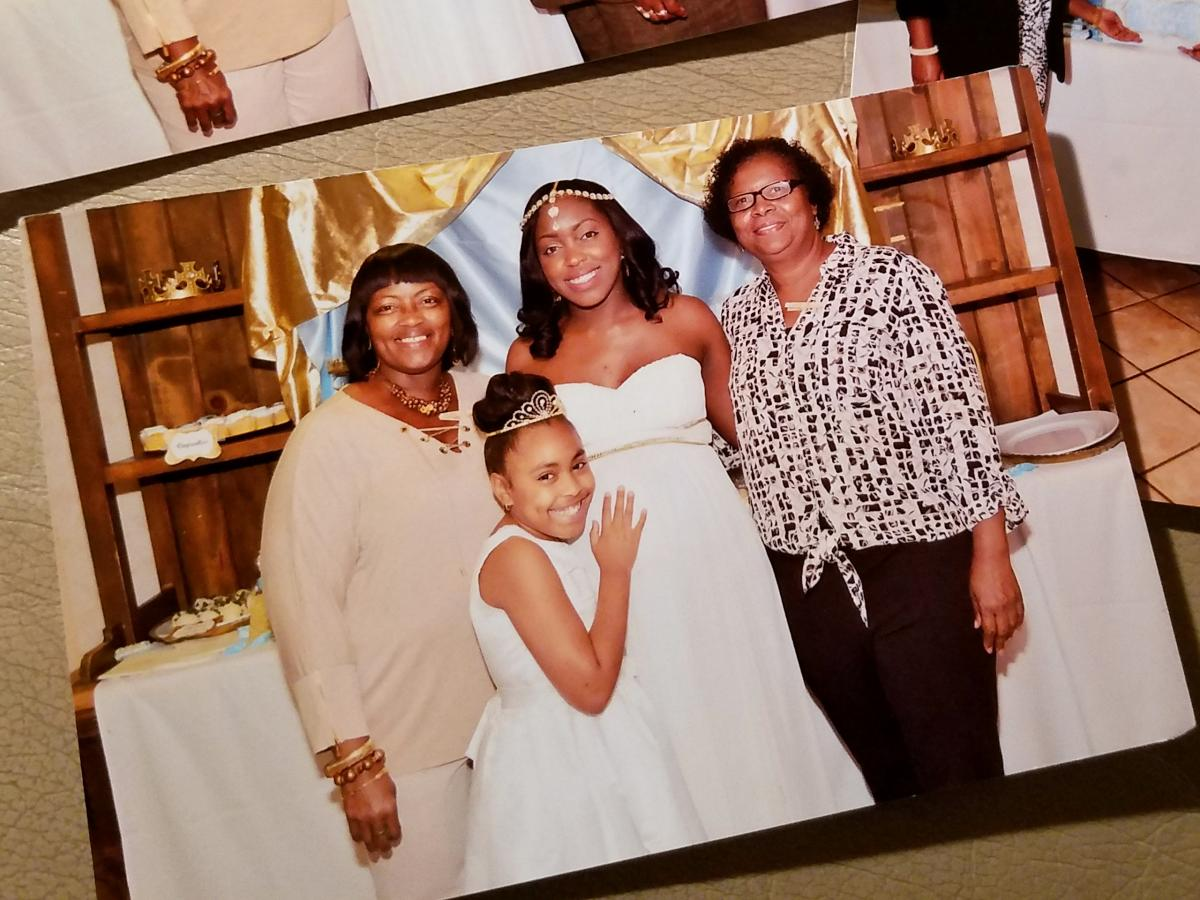 Brittney Mills (center) stands with her mother, Barbara (left), daughter, Kamille, and a family friend at her baby shower days before Brittney was killed.
