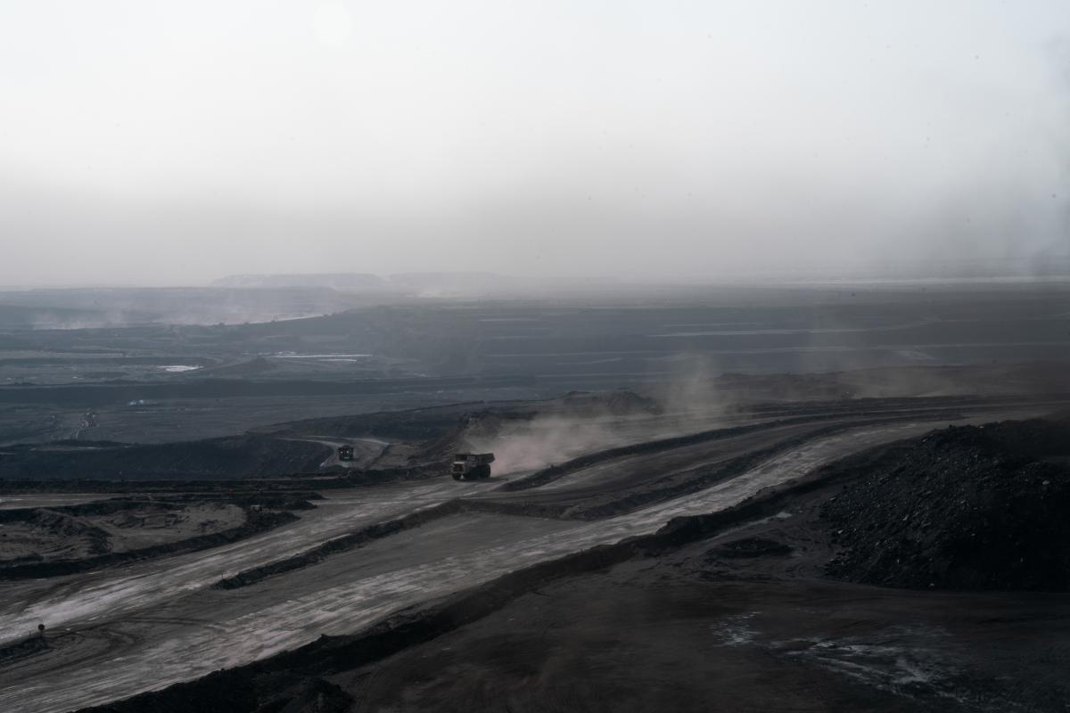 Trucks churn up coal dust at the Tavan Tolgoi coal mine in the South Gobi desert. The Tavan Tolgoi deposit is estimated to possess 6.5 billion tons of coal, including high-grade coking coal  —  a product vital to the steel-making process.