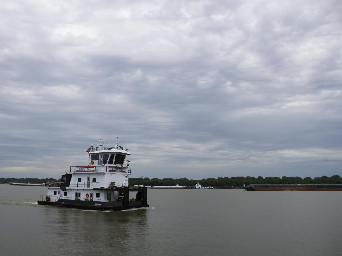 The Shawnee Forest towboat steers down the Ohio River near American Commercial Barge Line's office outside Cairo, Ill. As of June 12, more than 600 barges were waiting to go upstream once water levels dropped..