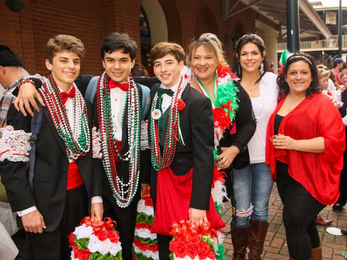 As they travel the parade route, tuxedoed men and youths distribute strings of colorful beads, dried fava beans and genuine Italian kisses.