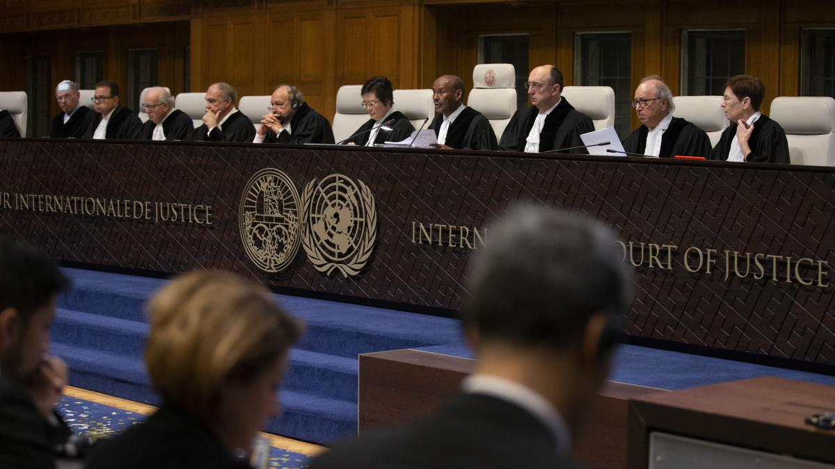 """Presiding Judge Abdulqawi Ahmed Yusuf, fourth from right, reads the ruling. The panel said Myanmar must take steps to protect the Muslim minority, who """"remain extremely vulnerable"""" after a brutal 2017 crackdown by the military."""