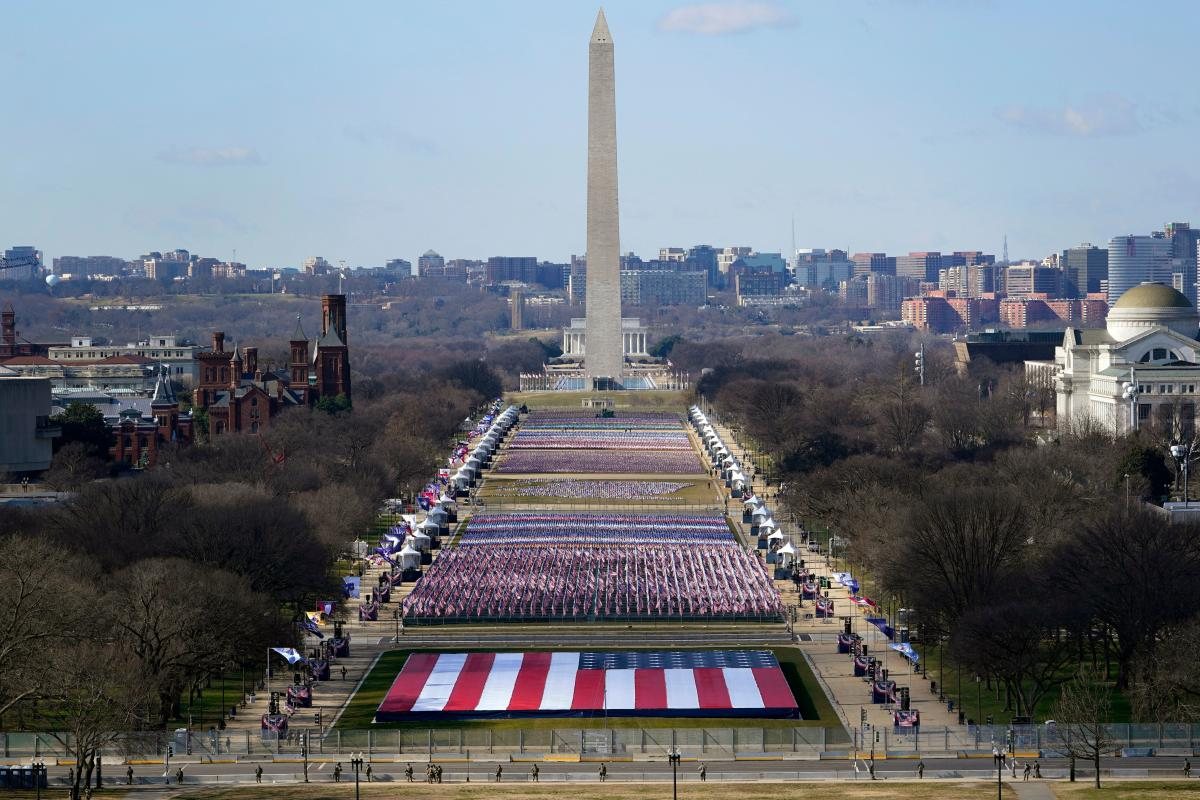 Nearly 200,000 flags on the National Mall represent the thousands of people who cannot attend the inauguration because of the pandemic and tight security in the nation's capital.