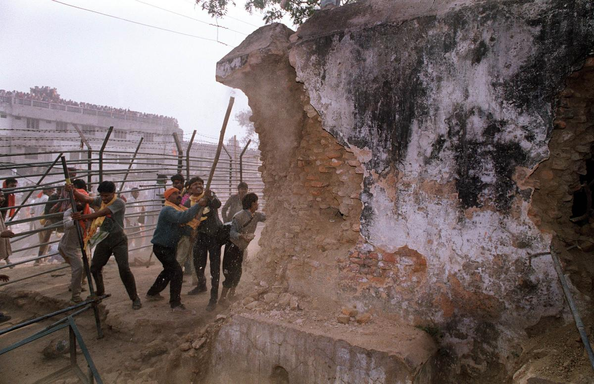 On Dec. 6, 1992, Hindu attackers hit the wall of the 16th century Babri Masjid with iron rods, part of a mob that tore down the mosque. Thousands were killed in rioting that followed the mosque's destruction.
