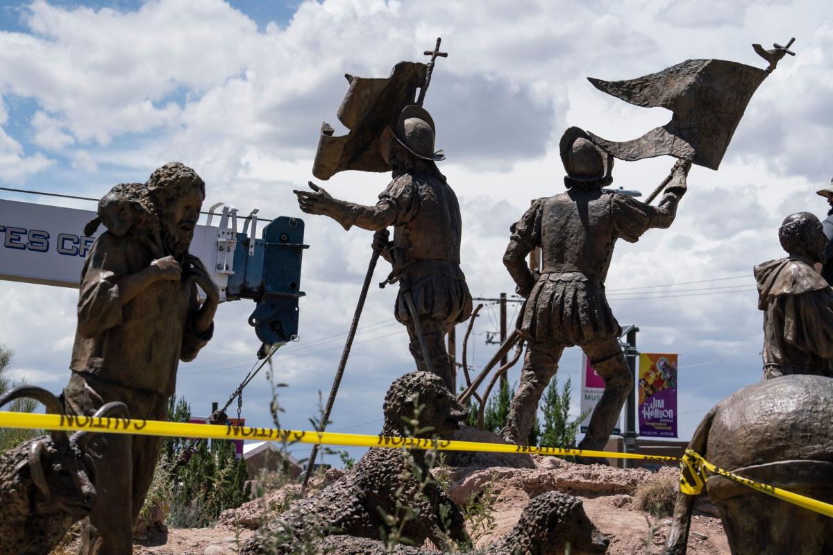 A sculpture of Juan de Oñate's settlers arriving in New Mexico is pictured as city workers remove a sculpture of the Spanish conquistador on June 16 in Albuquerque.