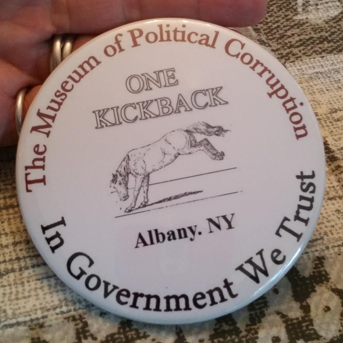 """Every member of the board for the Museum of Political Corruption received this """"kickback"""" button in their information folders at a recent meeting."""