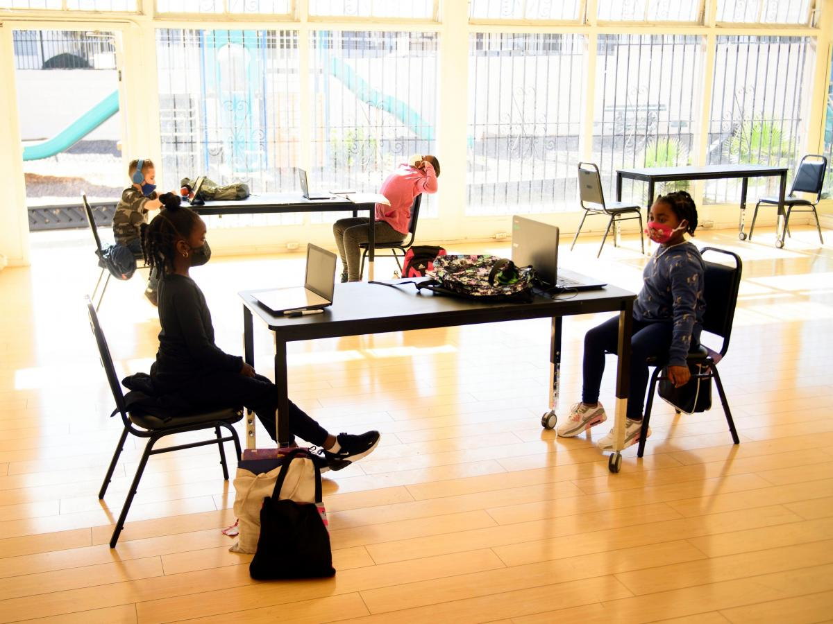 Children attend online classes at the Crenshaw Family YMCA in Los Angeles. Schools are having a hard time covering the costs required for in-person and online learning during the pandemic.