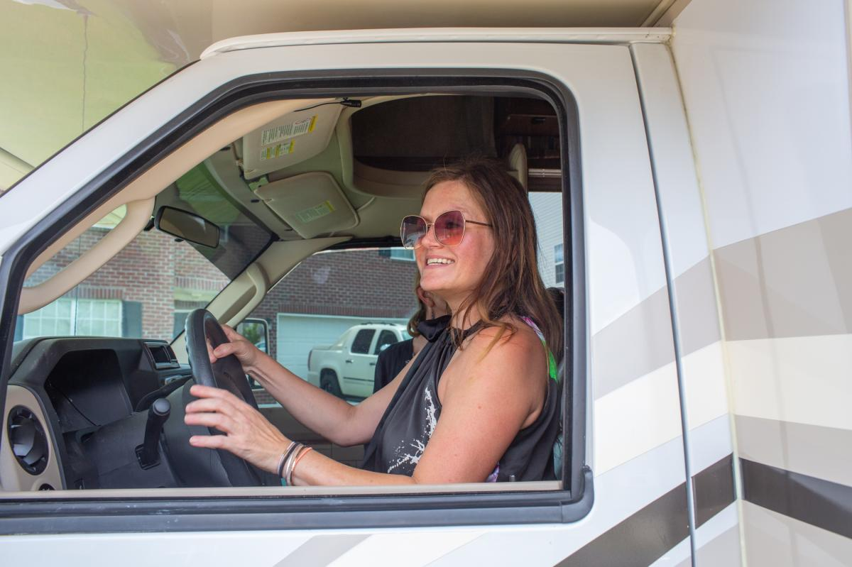 Amy Holditch settles in behind the wheel of the RV she rented for her 10-day family trip from Madison, Ala. to Cape Cod, Mass.