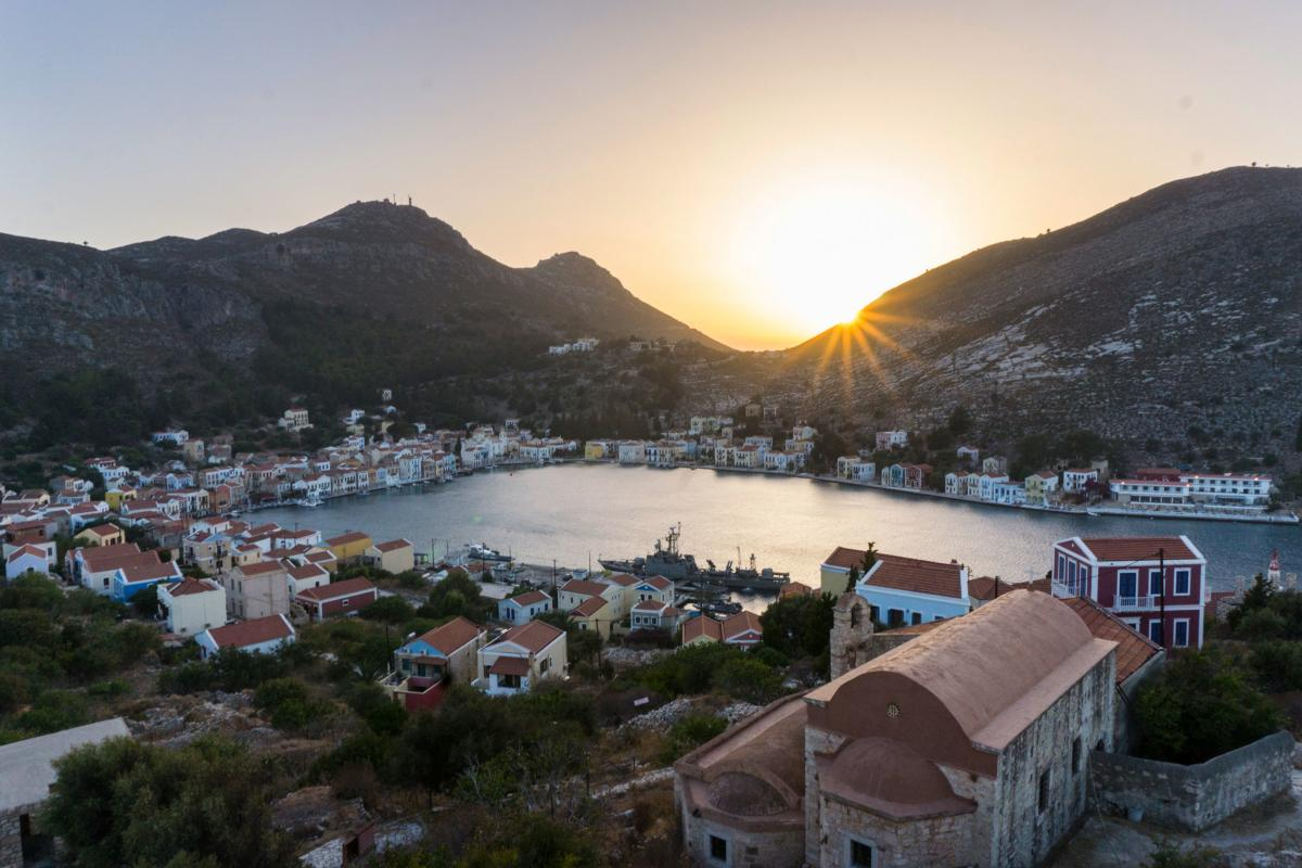 The Greek island of Kastellorizo, shown here at sunset from the top of an ancient castle, is a little over a mile away from the Turkish shore. Known for its architecture, turquoise sea and friendship with the neighbor Turks, it's recently become a pawn in