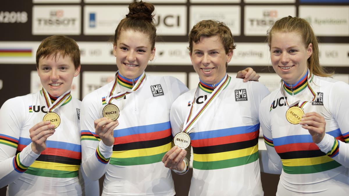 Cyclist Kelly Catlin (left) with her U.S. teammates after they won team pursuit gold medals at the world championships in the Netherlands last year.