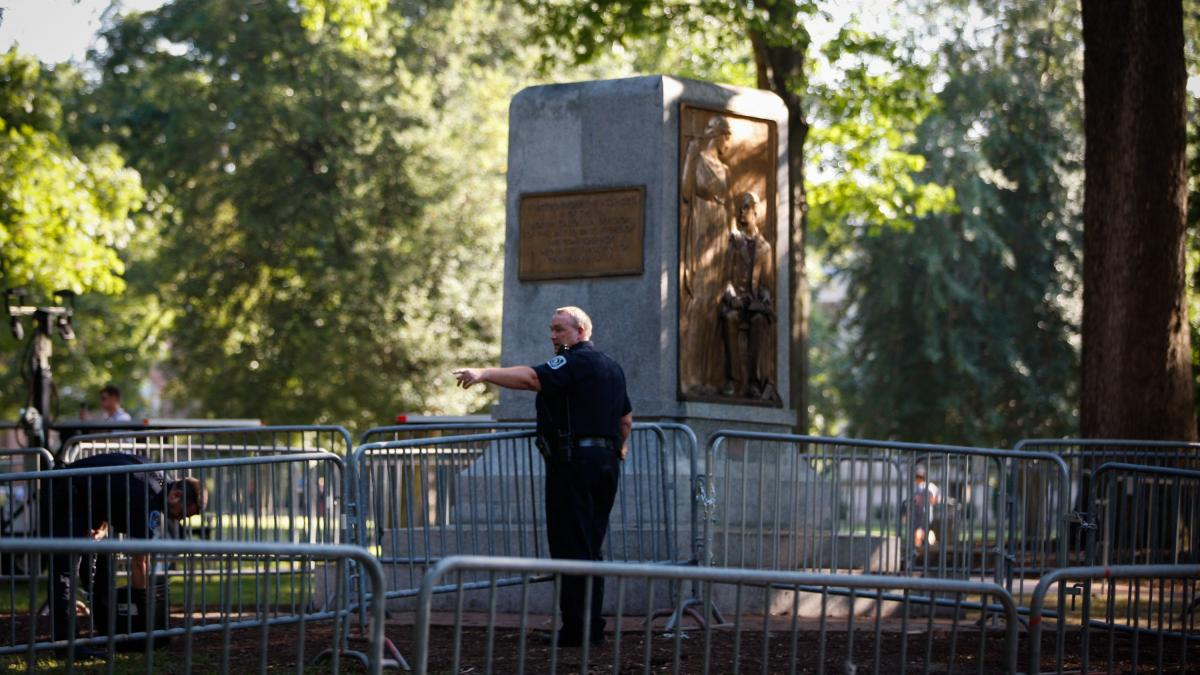 "In August 2018, law enforcement officials set up a perimeter around the platform that ""Silent Sam,"" a statue erected to honor Confederate dead, was toppled from."