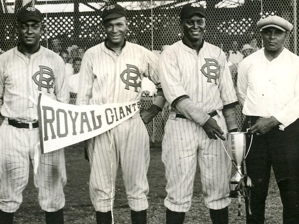 Pictured from left to right: catcher O'Neal Pullen, pitcher Ajay Johnson, shortstop Biz Mackey and manager Lonnie Goodwin