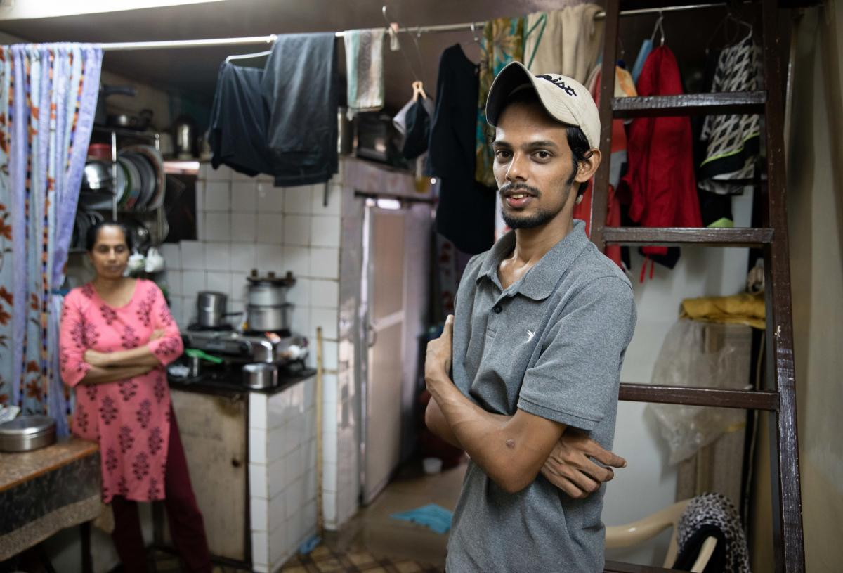 Salman Khan Rashid, 24, right, and his mother, Sana Rashid, at home. Salman lost his job as a golf coach at a Mumbai sports club during the pandemic. The household, which includes Salman's three sisters, is now surviving on savings. But when he's able, he