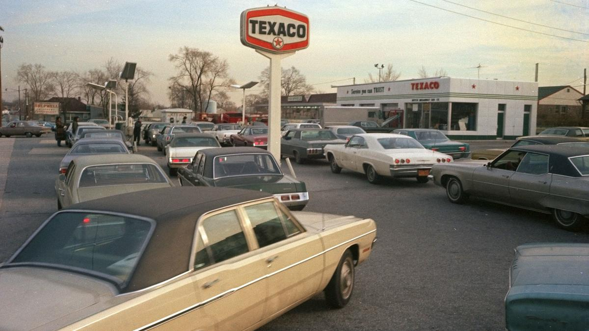 Motorists line up at a gas station on New York's Long Island, hoping to fill their tanks during the gasoline shortage of 1973-74. Long lines and fuel restrictions were common across the country.