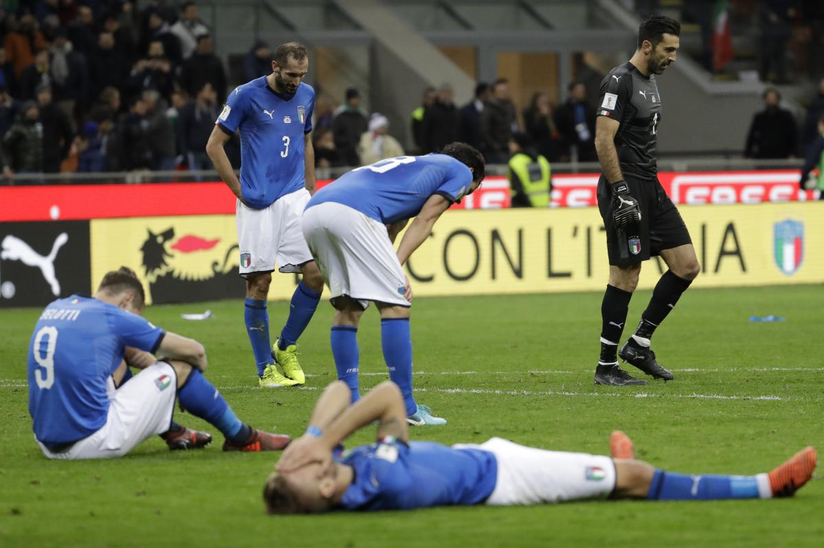 Italian national team players slump in dejection at the end of their World Cup qualifying match against Sweden on Monday. The 0-0 draw killed the four-time world champions' hopes of a spot in the 2018 tournament.