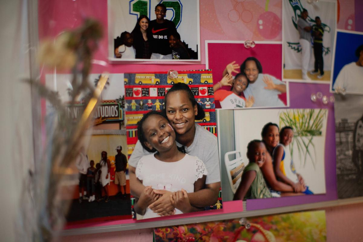 Photos of Daidre Kimp with her children posted on a bulletin board in her room.