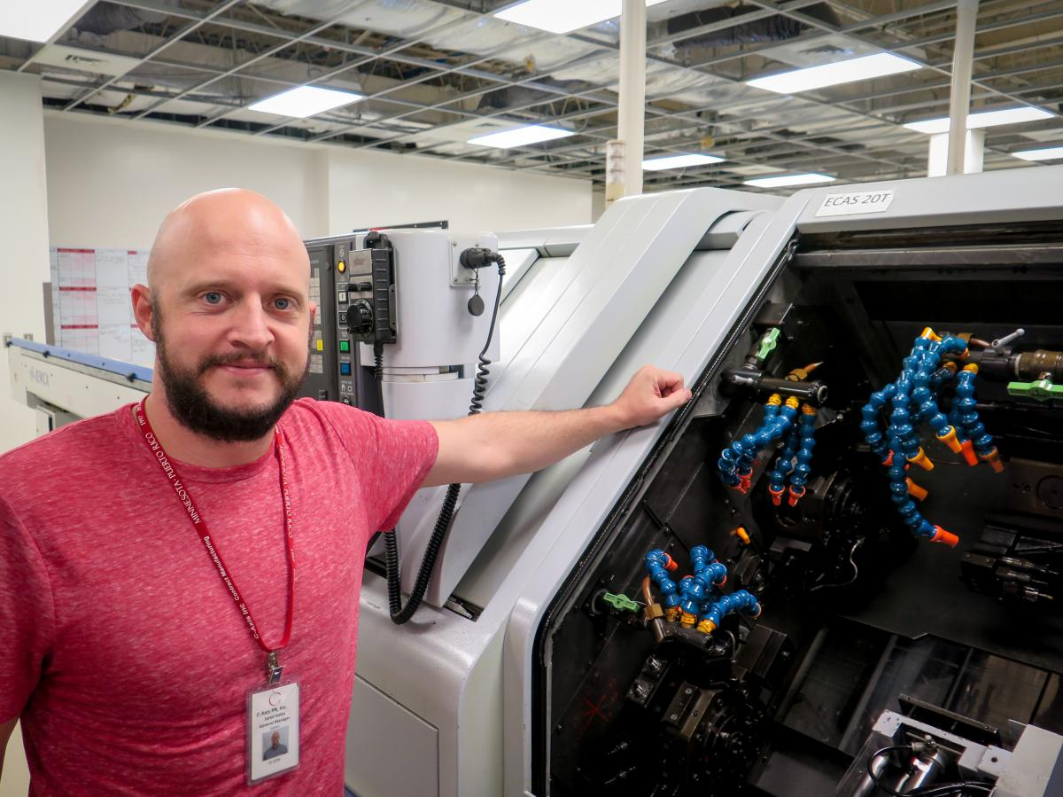 Jared Haley, general manager of the C-Axis plant in Caguas, Puerto Rico, says computer-operated milling machines, like this one can cost more than a half million dollars. Heat and humidity in the plant after Hurricane Maria left many of the machines inope
