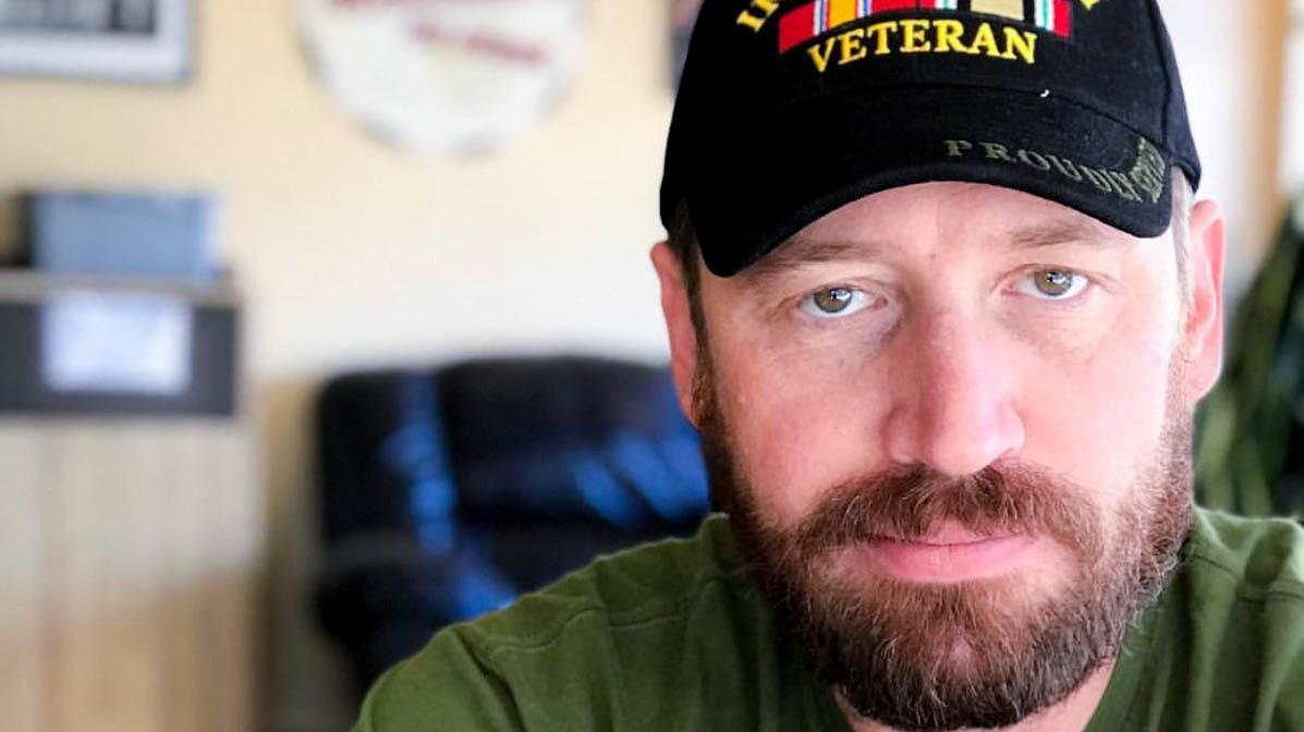 """""""I think in a lot of ways, we survived that deployment in Iraq by sharing humor with each other,"""" said former Army Spc. Garett Reppenhagen, seen at home in Colorado Springs, Colo."""