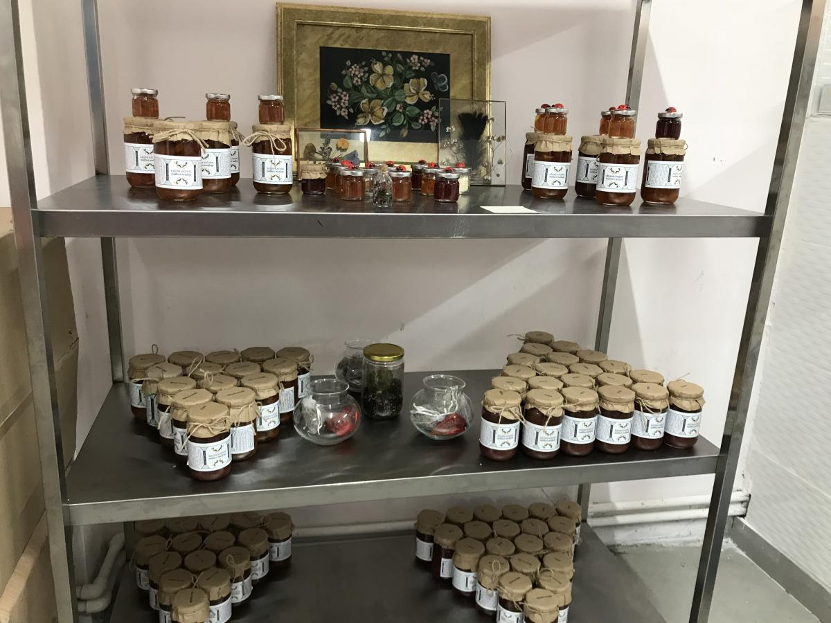 "Some of the jams and preserves made by the ""Women's Solidarity Kitchen"" in Istanbul, on display in their commercial kitchen."