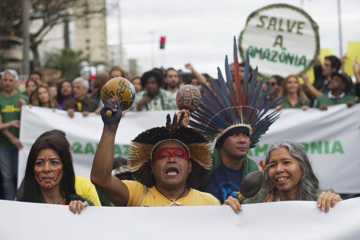 Indigenous people protest in defense of the Amazon in Rio de Janeiro on Sunday. Experts from the country's satellite monitoring agency say most of the fires are set by farmers or ranchers clearing existing farmland, but the same monitoring agency has repo