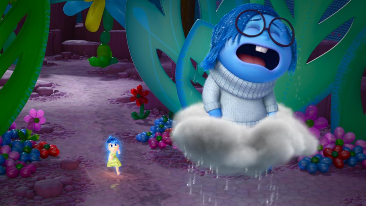 """""""[Sadness is] such a funny opposite energy to Joy, who is literally jumping up and down,"""" Poehler says. """"And Sadness just wants to lie down and kind of feel her feelings."""" Poehler plays Joy (left) and Phyllis Smith plays Sadness in the new film Inside Out"""