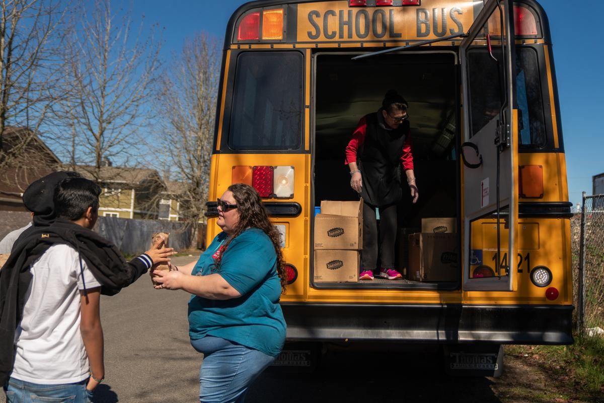 Franklin Pierce Schools bus driver Margie Huggler hands out free meals to students in Tacoma, Wash.