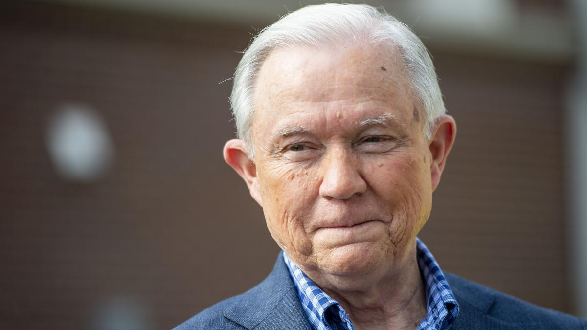 Jeff Sessions talks with the media after voting in Alabama's primary election in Mobile, Ala., on March 3. He faces Tommy Tuberville in Tuesday's Republican Senate runoff.