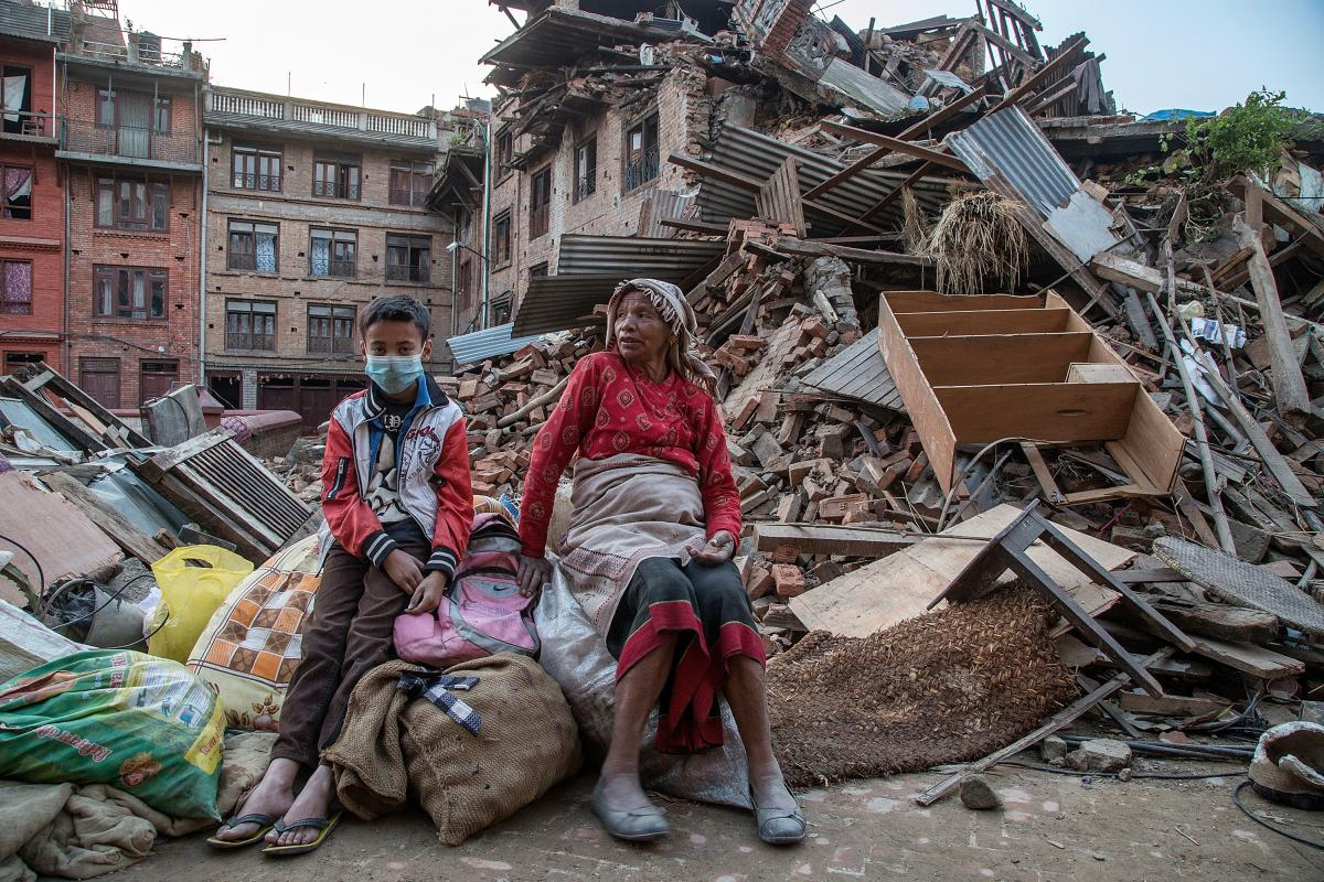A grandmother and her grandson sit on the belongings that they have salvaged from their collapsed homes on April 29, 2015 in Bhaktapur, Nepal.