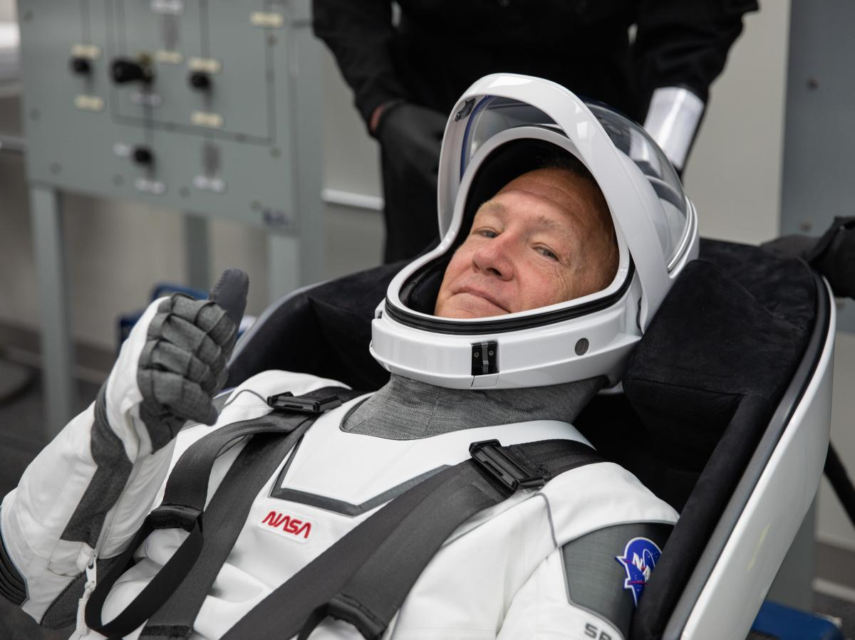 NASA astronaut Doug Hurley rehearses putting on his SpaceX spacesuit last week at the Neil A. Armstrong Operations and Checkout Building at Kennedy Space Center in Florida.