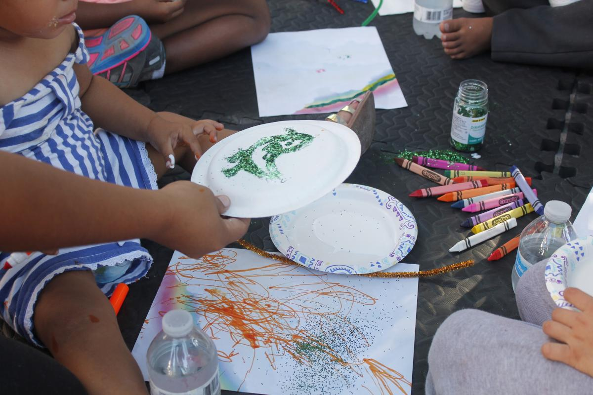 On a recent day, the sidewalk school in Matamoros, Mexico, began with arts and crafts.