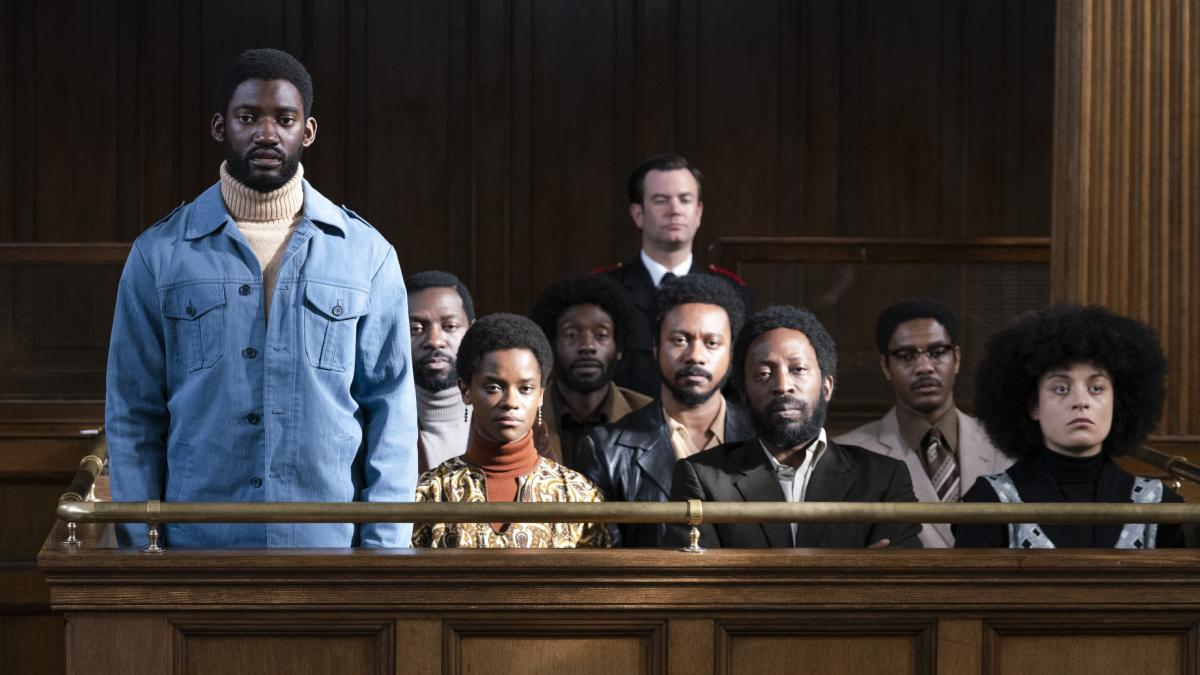 Malachi Kirby (standing) plays activist Darcus Howe in Mangrove, the first film in Steve McQueen's Small Axe anthology.