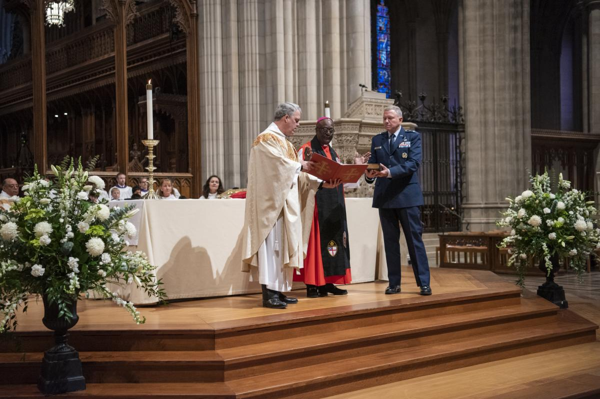 The Rev. Randolph Hollerith, dean of the Washington National Cathedral (from left); the Rev. Carl Wright, the Episcopal Church's bishop suffragan for the armed forces; and Maj. Gen. Steven Schaick, the Air Force chief of chaplains, participate in the bles