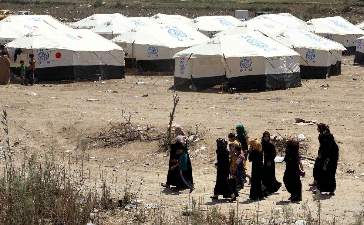 Displaced Sunni Iraqis, who fled the violence in Ramadi, arrive at a makeshift camp on the outskirts of Baghdad, in April.
