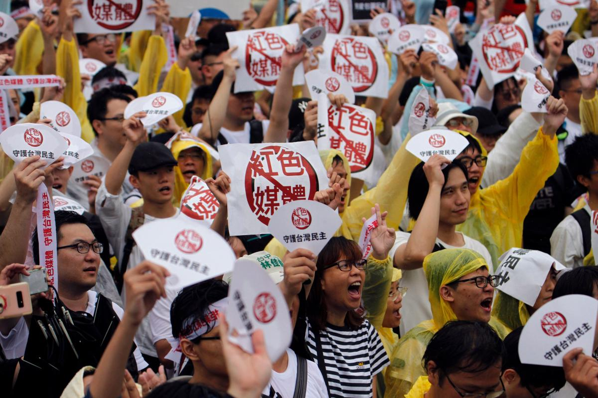 "Demonstrators protest against what they called ""red media"" influence in Taiwan during a rally against pro-China media in front of the president's office building in Taipei on June 23. With a presidential election in January, Taiwan is bracing for a new de"