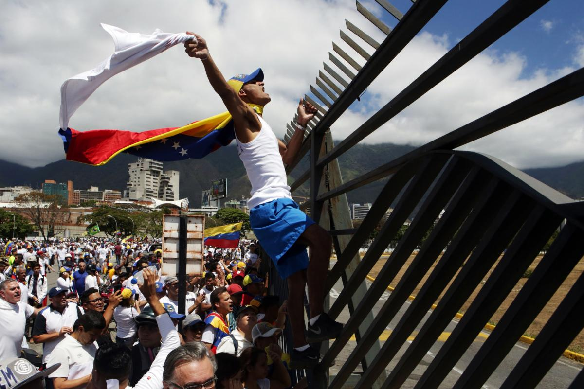 Supporters of Venezuelan opposition leader Juan Guaidó take part in a march in Caracas in February 2019. Amid Venezuela's isolation and catastrophic economic conditions, Guaidó emerged as a key challenger to Nicolás Maduro's rule, but has had difficult