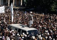 A Taliban mullah speaks to a crowd in central Kabul in early October 1996.