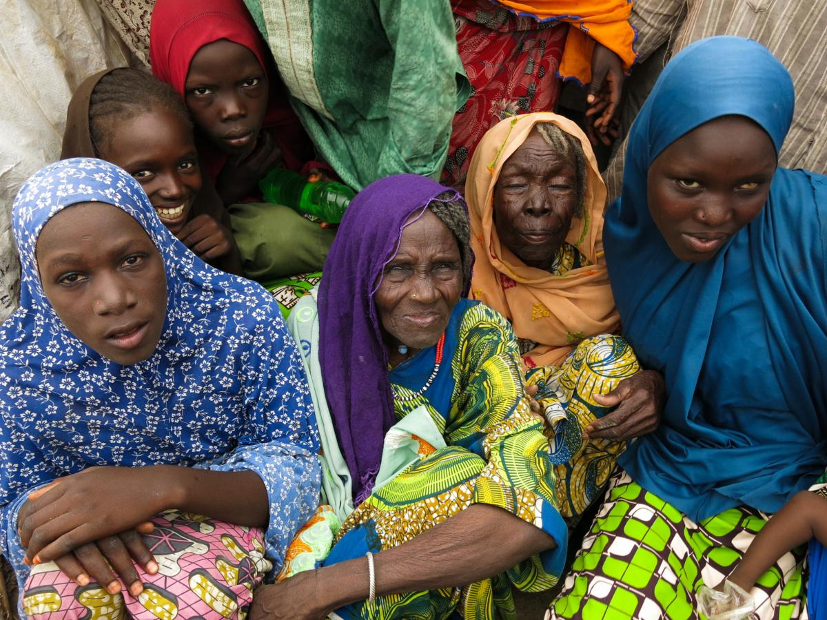Displaced women at the Muna informal settlement outside Maiduguri. They're among more than 2 million people driven from their homes by Boko Haram attacks during northeastern Nigeria's 7-year insurgency.