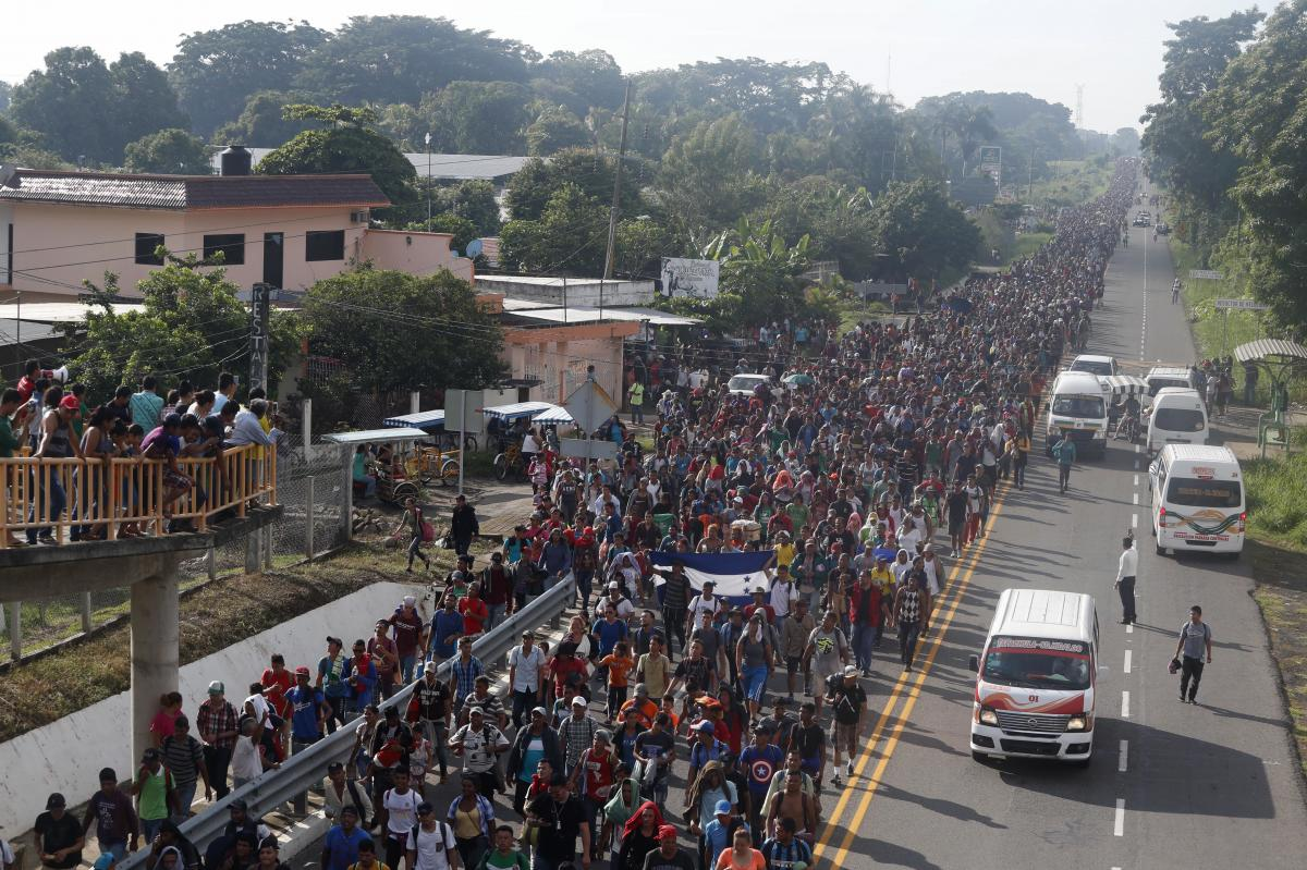 Central American migrants walking to the U.S. start their day departing Ciudad Hidalgo, Mexico, on Sunday. Despite Mexican efforts to stop them at the border, thousands of Central American migrants resumed their advance toward the U.S. border early Sunday