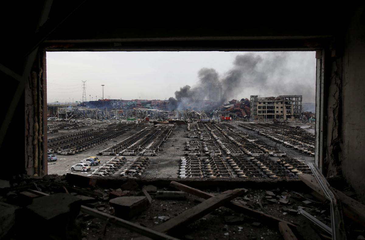 Smoke rises at the site of the explosions in Tianjin.
