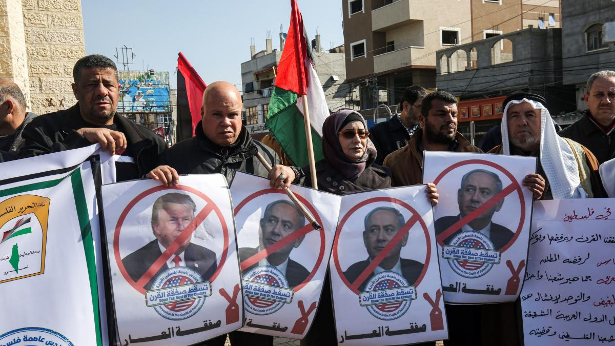 Palestinian demonstrators in Rafah, in the southern Gaza strip, hold portraits of President Trump and Israeli Prime Minister Benjamin Netanyahu during a protest against Trump's announcement of a peace plan on Tuesday.