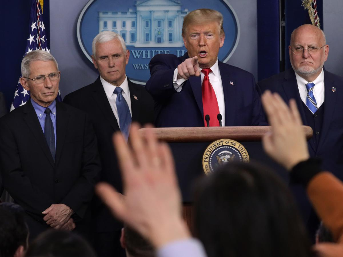 President Trump takes questions at a press conference with, from left, National Institute for Allergy and Infectious Diseases Director Anthony Fauci, Vice President Mike Pence and Centers for Disease Control and Prevention Director Robert Redfield.