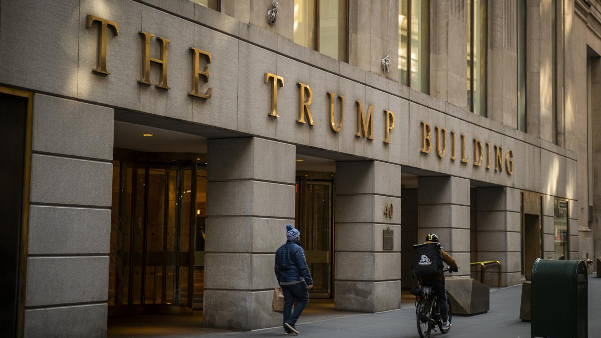 A pedestrian walks past the Trump Building in New York City in January.