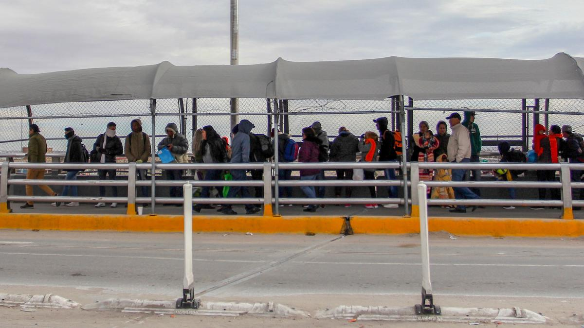 Migrants line up at the Paso del Norte International Bridge in Ciudad Juarez, Mexico, waiting to cross the border and request asylum in January. Thousands of asylum-seekers are waiting in Mexican border cities like Juarez right now, hoping for their turn