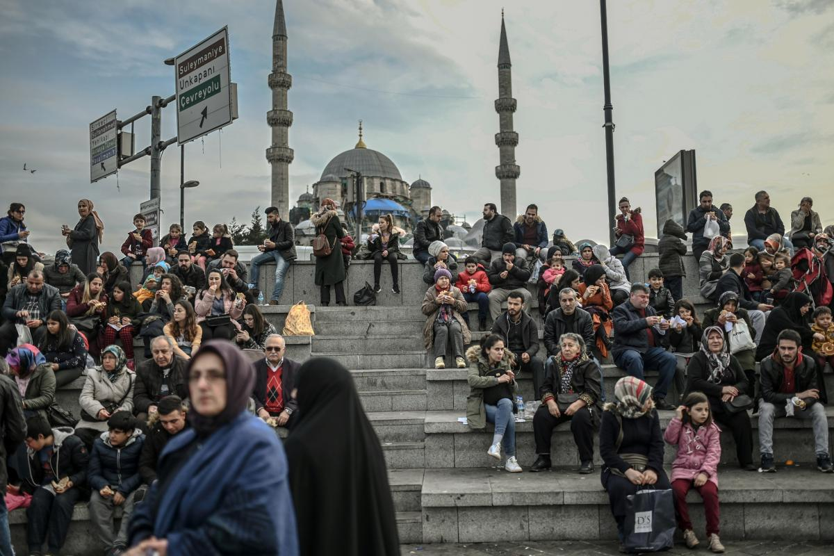 People enjoy an afternoon at Eminonu Square in Istanbul in January. A recent survey of personal beliefs and lifestyles in majority-Muslim Turkey has found a smaller portion of people describing themselves as religious.