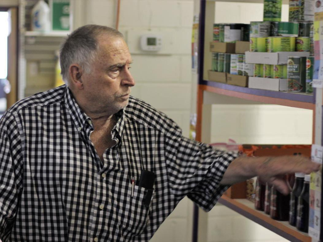 Leroy Bates shops at the Rising Up food pantry in Fort Morgan, Colo. Clients can visit it 13 times a year.