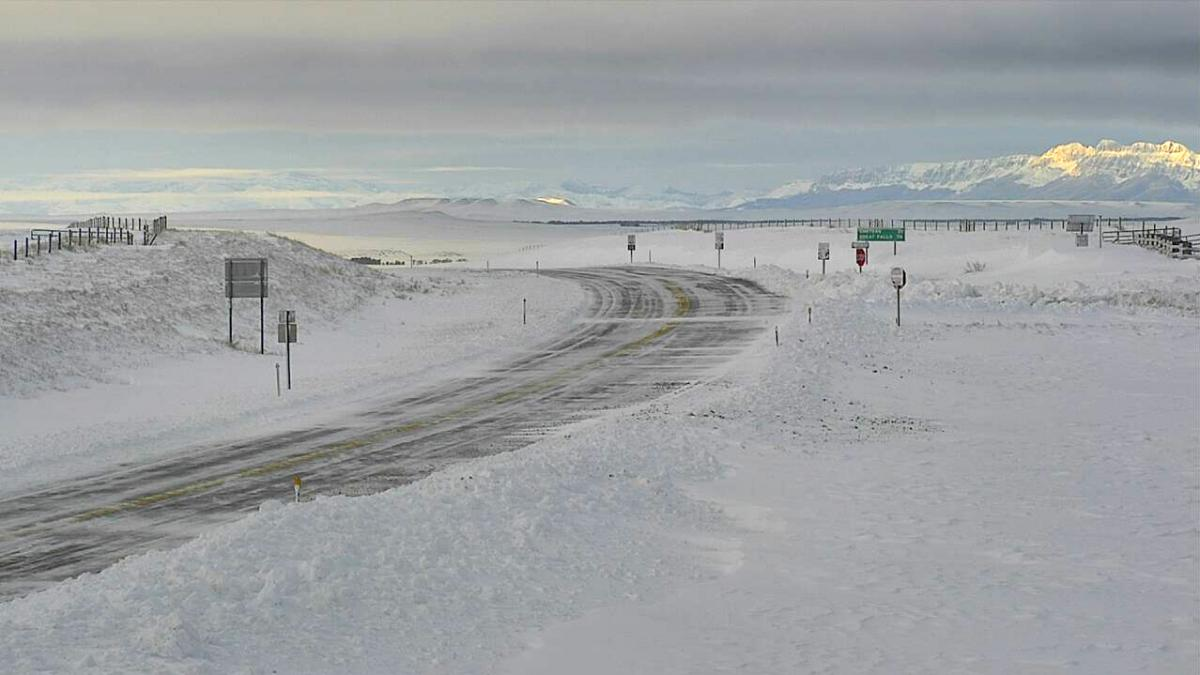 A highway webcam shows a snowy portion of U.S. Highway 89 near Pendroy, Mont., on Monday morning after a record-setting winter storm dumped snow on the northern Rockies.
