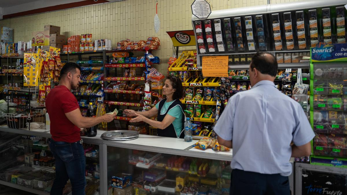 A person buys soda at a convenience store in San Luis Potosi, Mexico, on April 13. The country has high levels of obesity and medical conditions that health authorities warn are related to a diet high in soda and processed foods.