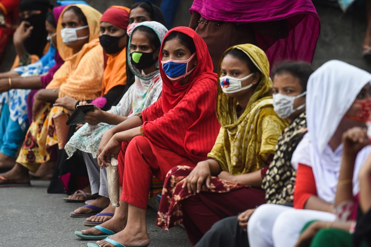 Workers from the garment sector block a road during a protest to demand payment of due wages, in Dhaka, Bangladesh, in April 2020. They claimed that factories had not paid them after retailers and brands cancelled orders due to worldwide lockdown measures